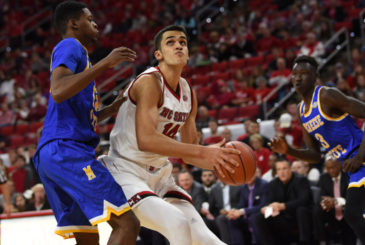 RALEIGH, NC - DECEMBER 22:  North Carolina State Wolfpack center Omer Yurtseven (14) goes up for a shot during the game between the McNeese St Cowboys and the North Carolina State Wolfpack on December 22, 2016 at PNC Arena in Raleigh, NC. NC State defeated McNeese State 89-75. (Photo by William Howard/Icon Sportswire)