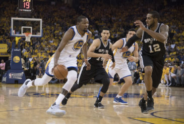 May 14, 2017; Oakland, CA, USA; Golden State Warriors forward Kevin Durant (35) dribbles the basketball against San Antonio Spurs forward LaMarcus Aldridge (12) during the second quarter in game one of the Western conference finals of the 2017 NBA Playoffs at Oracle Arena. Mandatory Credit: Kyle Terada-USA TODAY Sports