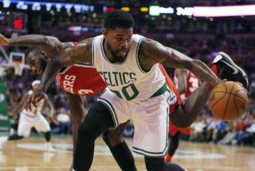 Philadelphia 76ers' JaKarr Sampson (9) fouls Boston Celtics' Amir Johnson (90) during the first quarter of an NBA basketball game in Boston, Wednesday, Nov. 25, 2015. (AP Photo/Michael Dwyer)