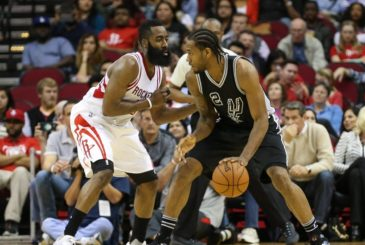 Feb 27, 2016; Houston, TX, USA; Houston Rockets guard James Harden (13) and San Antonio Spurs forward Kawhi Leonard (2) during a game at Toyota Center. Mandatory Credit: Troy Taormina-USA TODAY Sports