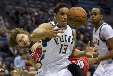 Oct 15, 2016; Milwaukee, WI, USA;  Milwaukee Bucks guard Malcolm Brogdon (13) battles for a rebound against Chicago Bulls center Robin Lopez (8) in the first quarter at BMO Harris Bradley Center. Mandatory Credit: Benny Sieu-USA TODAY Sports