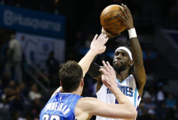 Mar 10, 2017; Charlotte, NC, USA; Charlotte Hornets guard Briante Weber (0) shoots the ball against Orlando Magic center Stephen Zimmerman (33) in the second half at Spectrum Center. The Hornets defeated the Magic 121-81. Mandatory Credit: Jeremy Brevard-USA TODAY Sports