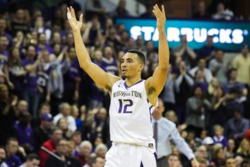 HUSKIES FILE --  Washington guard Andrew Andrews puts up his arms for the crowd to cheer a Malik Dime rebound in the second half as the University of Washington Huskies take on the Utah Utes at Alaska Airlines Arena in Seattle Sunday January 24, 2016. The Huskies lost in overtime, 80-75.