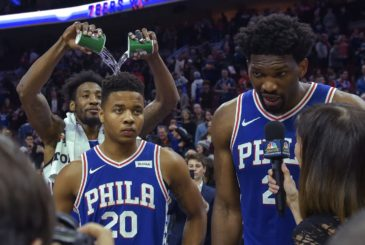 Mar 26, 2018; Philadelphia, PA, USA; Philadelphia 76ers forward Robert Covington (33) pours water on 76ers guard Markelle Fultz (20) during an interview after their game against the Denver Nuggets at the Wells Fargo Center. Mandatory Credit: John Geliebter-USA TODAY Sports