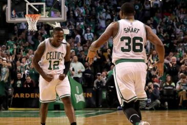 BOSTON - APRIL 30: Boston Celtics guard Terry Rozier (12) and Boston Celtics guard Marcus Smart (36) celebrate after Smart's three point jumper in the second quarter closed Washington's lead to within 3 points (40-37) over the Celtics. The Boston Celtics host the Washington Wizards in Game One of the NBA Eastern Conference Semi Final playoff series at TD Garden in Boston on Apr. 30, 2017. (Photo by Barry Chin/The Boston Globe via Getty Images)