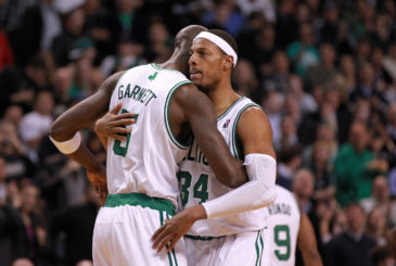HUG IT OUT: Paul Pierce is embraced by Kevin Garnett after passing Larry Bird for second on the Celtics' all-time scoring list in the third quarter of last night's game.