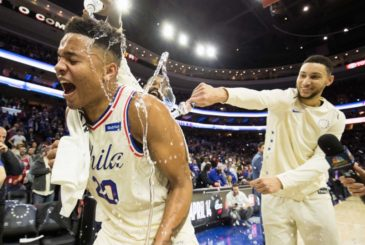 Apr 11, 2018; Philadelphia, PA, USA; Philadelphia 76ers guard Markelle Fultz (20) is doused with water by guard Ben Simmons (25) and center Amir Johnson (5) after recording his first triple double in a game against the Milwaukee Bucks at Wells Fargo Center. Mandatory Credit: Bill Streicher-USA TODAY Sports