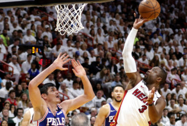 Miami Heat guard Dwyane Wade (3) shoots and scores in the fourth quarter as Philadelphia 76ers forward Ersan Ilyasova (23) defends during Game 4 of a first-round NBA basketball playoff series Saturday, April 21, 2018, in Miami. The 76ers won 106-102. (AP Photo/Joe Skipper) ORG XMIT: FLJS118