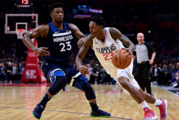LOS ANGELES, CA - DECEMBER 06:  Lou Williams #23 of the LA Clippers drives to the basket on Jimmy Butler #23 of the Minnesota Timberwolves during a 113-107 Timberwolves win at Staples Center on December 6, 2017 in Los Angeles, California.  (Photo by Harry How/Getty Images)