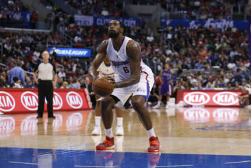 Los Angeles Clippers center DeAndre Jordan shoots a free throw against the Sacramento Kings during the first half of an NBA basketball game in Los Angeles, Saturday, April 12, 2014. The Clippers won 117-101. (AP Photo/Danny Moloshok)