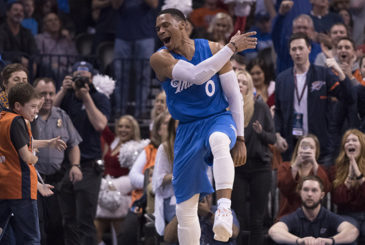 OKLAHOMA CITY, OK - DECEMBER 25:  Oklahoma City Thunder guard Russell Westbrook #0 reacts after the Thunder scored against the Minnesota Timberwolves during the second half of a NBA game at the Chesapeake Energy Arena on December 25, 2016 in Oklahoma City, Oklahoma. The Thunder defeated the Timberwolves 112-100.  NOTE TO USER: User expressly acknowledges and agrees that, by downloading and or using this photograph, User is consenting to the terms and conditions of the Getty Images License Agreement. (Photo by J Pat Carter/Getty Images)