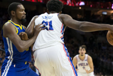 PHILADELPHIA, PA - NOVEMBER 18: Joel Embiid #21 of the Philadelphia 76ers backs to the basket against Kevin Durant #35 of the Golden State Warriors in the first half at Wells Fargo Center on November 18, 2017 in Philadelphia,Pennsylvania. NOTE TO USER: User expressly acknowledges and agrees that, by downloading and or using this photograph, User is consenting to the terms and conditions of the Getty Images License Agreement. (Photo by Rob Carr/Getty Images)