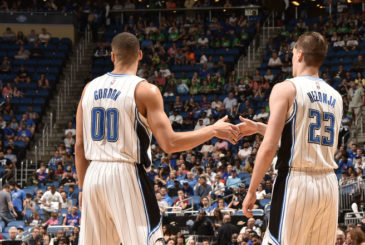 ORLANDO, FL - APRIL 6:  Aaron Gordon #00 of the Orlando Magic shakes hands with Mario Hezonja #23 of the Orlando Magic during the game against the Detroit Pistons on April 6, 2016 at Amway Center in Orlando, Florida. NOTE TO USER: User expressly acknowledges and agrees that, by downloading and or using this photograph, User is consenting to the terms and conditions of the Getty Images License Agreement. Mandatory Copyright Notice: Copyright 2016 NBAE (Photo by Fernando Medina/NBAE via Getty Images)