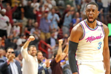 The Miami Heat's Dwyane Wade celebrates with the crowd after scoring the winning basket in the final seconds against the Philadelphia 76ers at the AmericanAirlines Arena in Miami, on Tuesday, Feb. 27, 2018. The Heat won, 102-101. (Charles Trainor Jr./Miami Herald/TNS via Getty Images)