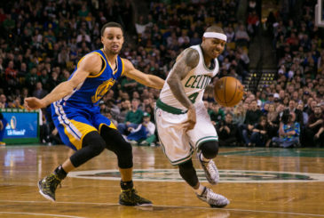 (Boston, Mass., 03/01/15) -- Celtics guard Isaiah Thomas drives past Warriors guard Stephen Curry in the first half of their NBA basketball game at TD Garden on March 1, 2015. Herald Photo by KELVIN MA.