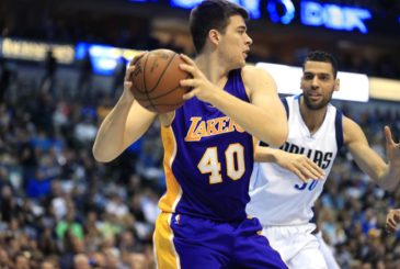 Los Angeles Lakers center Ivica Zubac (40) looks to pass against Dallas Mavericks center Salah Mejri (50) during the first half of an NBA basketball game, Sunday, Jan. 22, 2017, in Dallas. (AP Photo/Ron Jenkins)