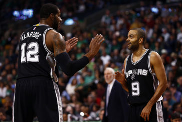 Nov 1, 2015; Boston, MA, USA; San Antonio Spurs guard Tony Parker (9) and forward LaMarcus Aldridge (12) speak during the first half of a game against the Boston Celtics at TD Garden. Mandatory Credit: Mark L. Baer-USA TODAY Sports