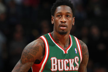 Milwaukee Bucks center Larry Sanders takes court to face the Denver Nuggets in the first quarter of an NBA basketball game in Denver on Wednesday, Feb. 5, 2014. (AP Photo/David Zalubowski)