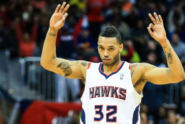 Feb 22, 2014; Atlanta, GA, USA; Atlanta Hawks power forward Mike Scott (32) celebrates a three by shooting guard Louis Williams (3) in the second half against the New York Knicks at Philips Arena. The Hawks won 107-98. Mandatory Credit: Daniel Shirey-USA TODAY Sports