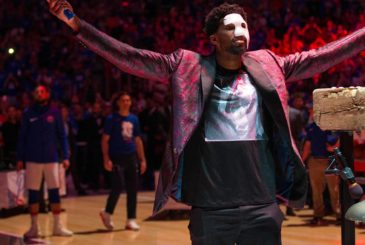 Apr 14, 2018; Philadelphia, PA, USA; Philadelphia 76ers center Joel Embiid (21) wears a phantom of the opera mask as he rings the ceremonial bell to start a game against the Miami Heat in game one of the first round of the 2018 NBA Playoffs at Wells Fargo Center. Mandatory Credit: Bill Streicher-USA TODAY Sports
