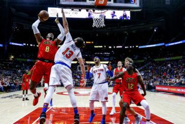 Jan 29, 2017; Atlanta, GA, USA;  Atlanta Hawks center Dwight Howard (8) puts up a shot over New York Knicks center Joakim Noah (13) during the first half at Philips Arena. Mandatory Credit: Butch Dill-USA TODAY Sports