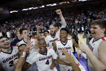 Gonzaga players celebrate after defeating Saint Mary's in an NCAA college basketball game during the championship of the West Coast Conference tournament, Tuesday, March 7, 2017, in Las Vegas. Gonzaga won 74-56. (AP Photo/John Locher)