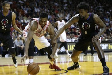 Miami Heat center Hassan Whiteside (21) goes for a loose ball with Los Angeles Clippers center DeAndre Jordan (6) during the second half of an NBA basketball game, Sunday, Feb. 7, 2016, in Miami. The Clippers defeated the Heat 100-93. (AP Photo/Lynne Sladky)